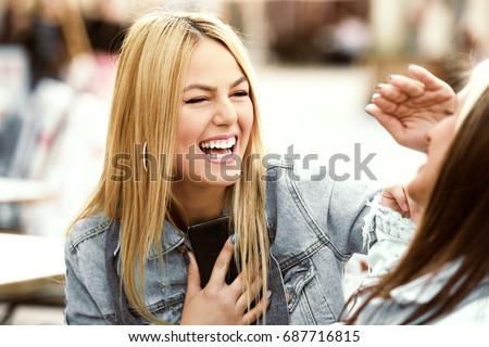 Happy young women having fun in coffee shop. #687716815