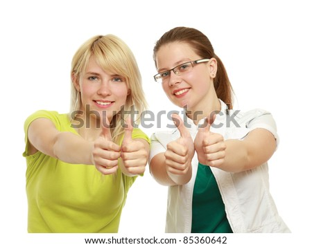 Happy young women showing thumbs up isolated