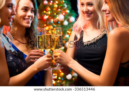 Happy young women with glasses of champagne. Xmas #336513446