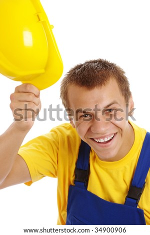 Happy young worker take off his yellow hard hat, isolated over white