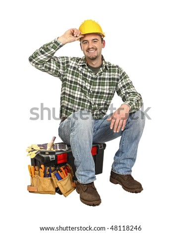 happy young worker take rest sit on his toolbox