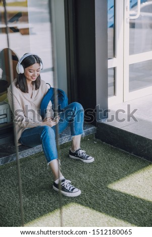Happy young young woman using her new cellphone. Modern technology concept