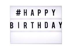 Happybirthday text in a light box. Box isolated over white background. A sign with a message