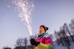 Happygirk having fun on winter vacation - Young woman with snow suit partying outdoors
