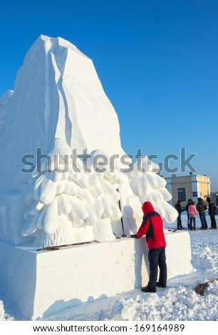 HARBIN, CHINA - DECEMBER 30, 2013: Building snow sculptures. located in Harbin Ice and Snow World. December 30, 2013 in Harbin City, Heilongjiang Province, China.