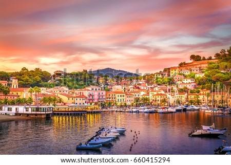 Stock Photo Harbor and village  Porto Azzurro at sunset, Elba islands, Tuscany, Italy.