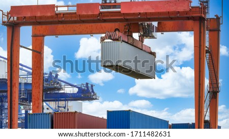 Harbor cargo cranes shipping port equipment, Industrial port crane, Logistics business huge cranes and containers, Cargo freight ship with industrial crane, Container ship in import export business.