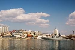 harbor city of Vladivostok with Russian warships