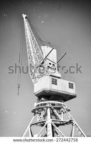 harbor crane. old style photo...