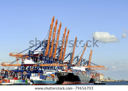Harbor cranes  and container ship in harbor of rotterdam