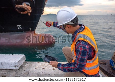 harbor master supervisor is survey and inspection of the safty berthing along side of the ship vessel mooring in port terminal, report and communication by radio walkie talkie and device swift on line