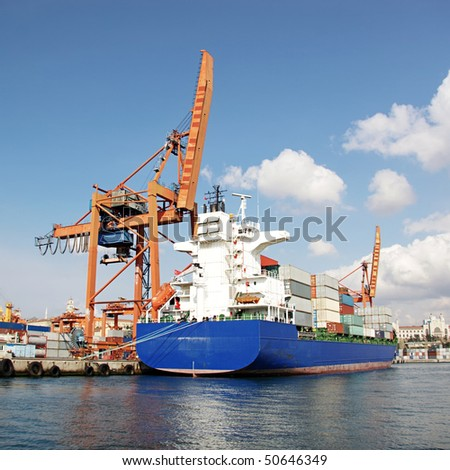 Harbor with blue container ship