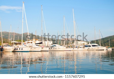 Harbor with yachts and sailboats at sunrise