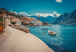 Harbour and boats in sunny day at Boka Kotor bay (Boka Kotorska), Montenegro, Europe. Retro toned image.