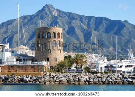 Harbour entrance with the watchtower to the left and La Concha mountain to the rear, Puerto Banus, Marbella, Costa del Sol, Malaga Province, Andalusia, Spain, Western Europe.
