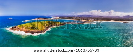Harbour of regional town Coffs Harbour in Australia with Muttonbirds island and protected town marina off sandy beaches on a sunny summer day. #1068756983