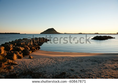 Harbour view to Mount Maunganui and Tauranga entrance as the sun rises.