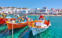 Harbour with wooden fishing boats in Chora town on sunny summer day, Mykonos island, Greece -- Greek landscape