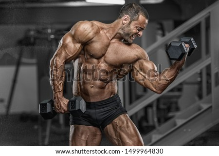 Hard Core Bodybuilding. Handsome Bodybuilder Workout at the Gym