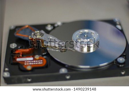 Hard disk drive, random access information storage device based on the principle of magnetic recording. It is the main data storage device in most computers.  needle head and magnetic disk #1490239148