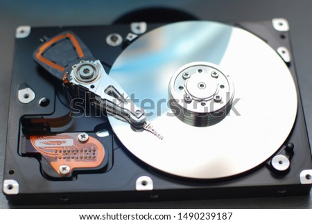 Hard disk drive, random access information storage device based on the principle of magnetic recording. It is the main data storage device in most computers.  needle head and magnetic disk #1490239187