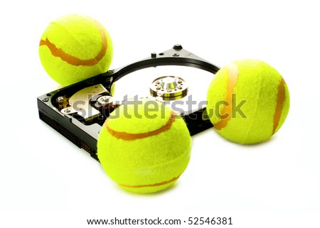 Hard disk with tennis balls isolated on white background - stock photo