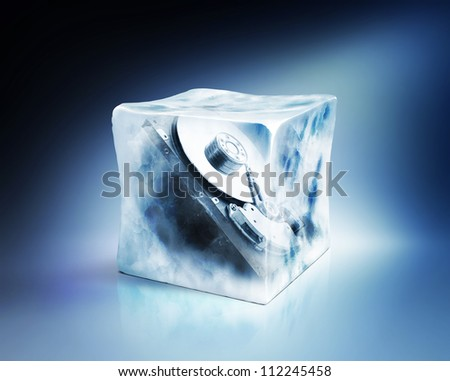 Hard drive frozen in ice cube, data storage concept, isolated path included