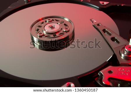 Hard drive internal metallic disks and mechanisms over red light