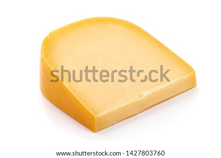 Hard Dutch gouda cheese, close-up, isolated on white background.