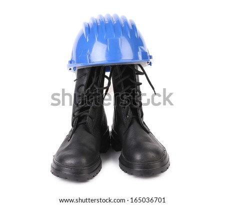 Hard hat and working boots. Isolated on a white background.