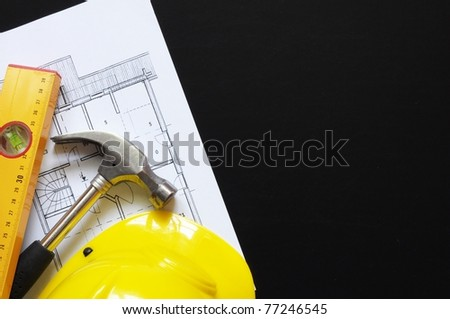 hard hat hammer and tools with copyspace showing home worker concept