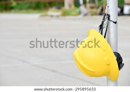 Hard hat hanging in pole while relax in hard work