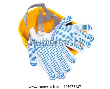 hard hat upside down and gloves, small natural shadow under object