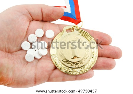 Hard life in sport concept, gold medal and tablets on hand isolated
