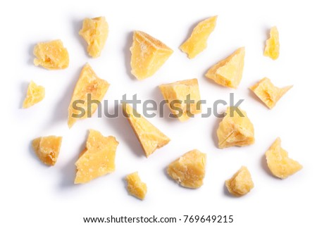 Hard mature cheese (Parmesan, Parmigiano), rough pieces. Clipping paths, shadow separated, top view