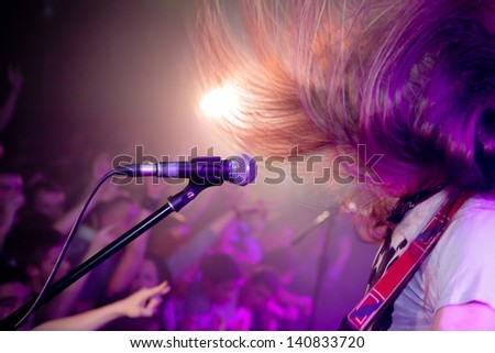 Hard rock musicians playing at a concert