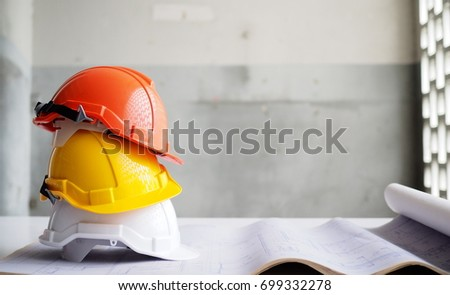 Hard safety helmet hat for safety project of workman as engineer or worker on concrete floor. #699332278
