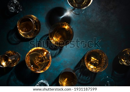 Hard strong alcoholic drinks, spirits and distillates in glasses: vodka, cognac, tequila, scotch, brandy and whiskey, grappa, vermouth, rum. Blue background, top view Сток-фото ©