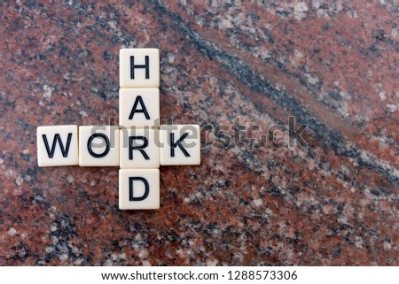 Hard Work. Work Hard. In business, education and life people need to choose to work hard and to learn from hard work. Tile letters joint with marbled background. #1288573306