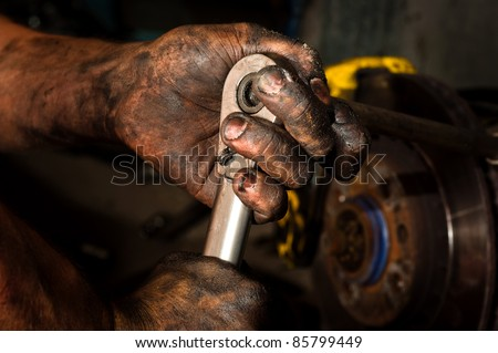 Hard working man with hands full of oil