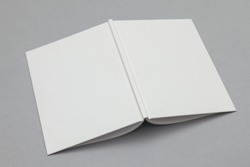 Hardback book mockup. White book on a grey background
