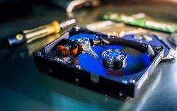 harddisk magnetic tape inside , open cover harddisk, A close up shot of harddisk