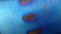 Hardened metal surface. Bluish vintage background. Industrial background