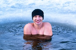 Hardening the body from diseases in cold water. Winter swimming in the ice hole.