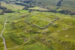 Hardknott Roman Fort is an archeological site, the remains of the Roman fort Mediobogdum, located on the western side of the Hardknott Pass in the English county of Cumbria