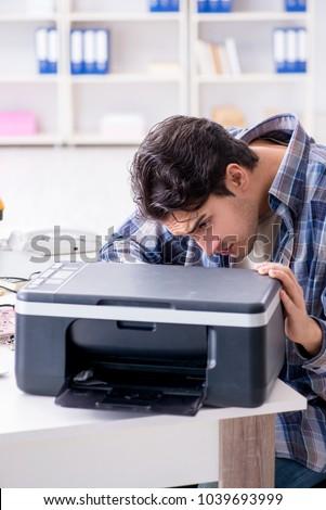 Hardware repairman repairing broken printer fax machine