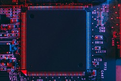 Hardware technology concept in neon light. Motherboard in blue-red light. Computer  component. Dark photo.Neon Colors.GPU processor. CPU
