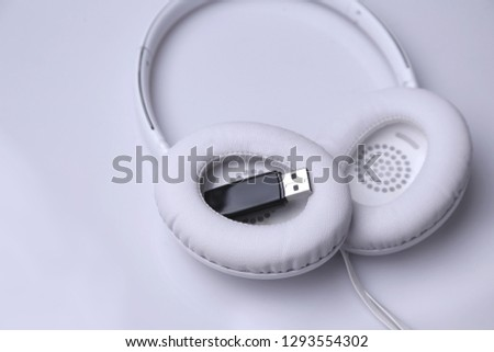 hardwares, electronics device, flash drive, flash memory.  hardware, hardwarestores, energy, electronic. Headphone, headphones technology, misic acoustics.  portable disc and charge usb devices #1293554302