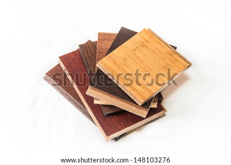 Hardwood flooring samples including maple oak bamboo and cork