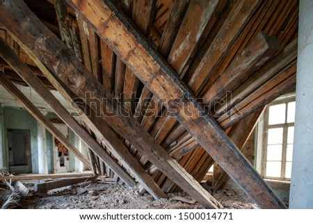 hardwood floors roof of building collapsed inwards in an empty room who has suffered damage from a hurricane, earthquake human habitation, with widespread destruction and possibly under rubble victim